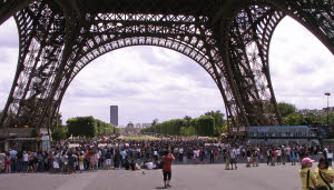 crowd beneath the Eiffel Tower