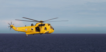 rescue helicopter leaving the ship
