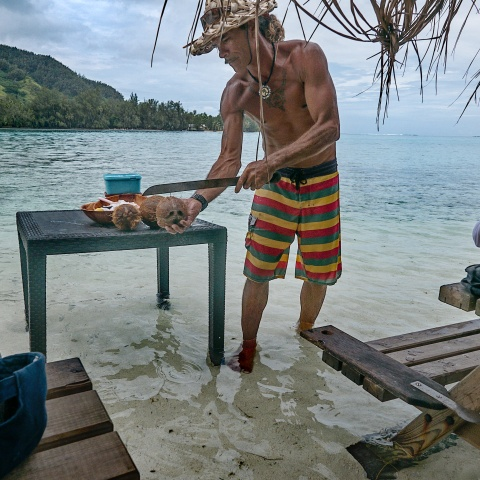 cutting coconut in the ocean